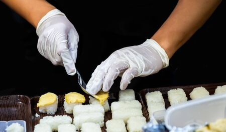 Making a dessert in Thai dessert traditional by apply from Sushi japanese style.