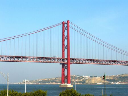 tagus: Modern red bridge over river Tagus in Lisbon, Portugal Stock Photo