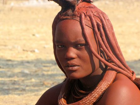 NAMIBIA, AUGUST 29, 2009: Young women in the village of Himba people near Opuwo in northern Namibia