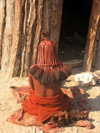 NAMIBIA, KAOKOVELD, AUGUST 29: Himba woman presenting her braids in the village of Himba people near Opuwo in northern Namibia, August 29, 2009, Namibia