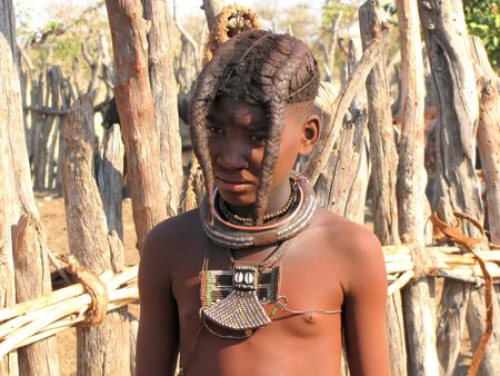 NAMIBIA, AUGUST 29: Young girl is presenting her braids in the village of Himba people near Opuwo in northern Namibia, August 29, 2009, Namibia Photo taken on: August 29, 2009 Stock Photo - 6889280