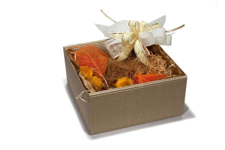 Gift box fitted with dried autumn style flowers photo