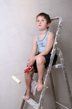 Tired boy on the ladder photo