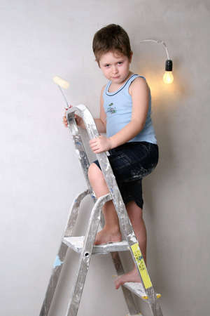 Angry boy on the ladder photo