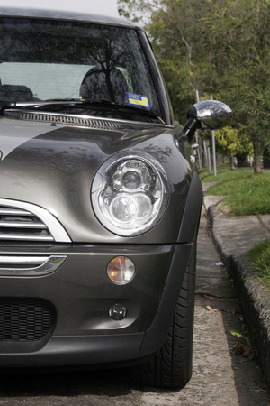 Front Of A Grey Metallic Small Car On A Street Stock Photo