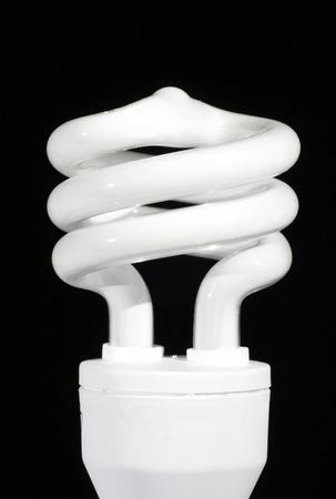 Spiral Energy Saving Lightbulb On A Black Background photo