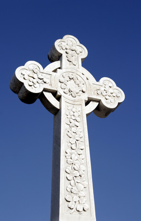 White Grave Stone Cross In Front Of Clear Blue Sky