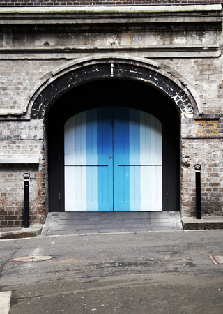 backstreet: Colourful Blue Door In An Old Brick Wall, Backstreet Entrance, Background
