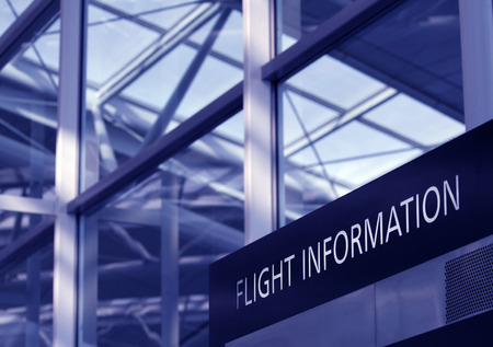 Flight Information Sign, Glass Facade Of An Airport Interior, Blue Toning