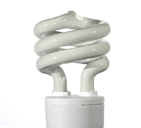 Spiral Energy Saving Light Bulb On A White Background photo