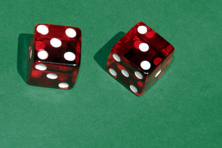 Red Dices showing Five and Three On Top, Green Casino Table Background photo
