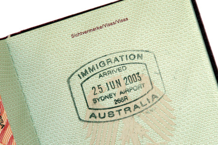 visa: Immigration Australia - Immigration Stamp for Arrival In Australia On Green Passport Page Stock Photo