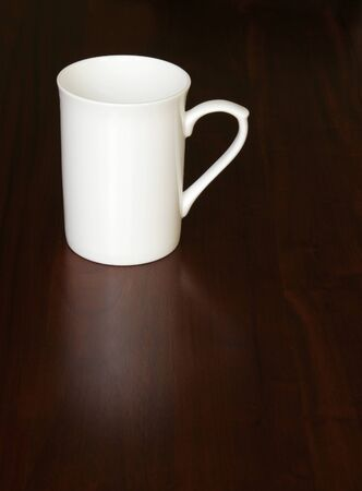 White Empty Coffee Cup On A Dark Wooden Table, Reflection photo