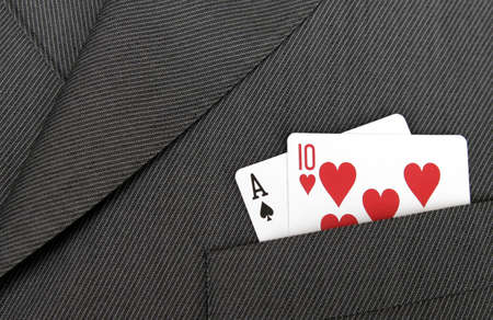 Card Suit - Ace Of Spades And Ten Of Hearts Gambling Cards In A Suit Jacket Pocket Stock Photo - 1696623