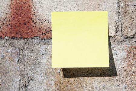 Yellow Simple Plain Blank Post-It Note On A Brick Wall, Space For Own Text, Background photo