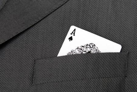 as de picas: Card Suit - Ace Of Spades Juego de tarjeta en un bolsillo de chaqueta Foto de archivo