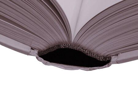 illiteracy: Grueso libro abierto, p�ginas en blanco sobre un fondo blanco, c�lido tono  Foto de archivo