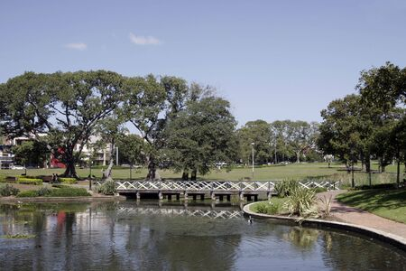 Little Bridge With Water Reflection In A Pond, Public Park, Trees, Sydney, Australia photo