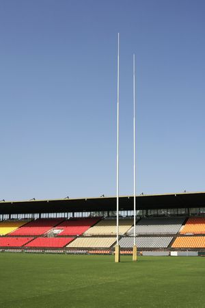 rostrum: Many Empty Seats In Rows In An Outdoor Sports Stadium