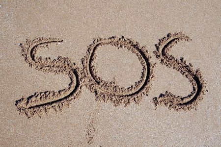 СОС: SOS Inscription On A Sand Beach At The Pacific Coast