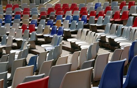 Colourful Empty Stadium Seats In Rows photo