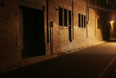 Mysterious Alley - Dark Abandoned Street With Lights Shining On A Brick Wall Stock Photo - 1777721