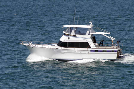 Speedboat Cruising The Sea With High Speed, Outdoor, Blue Ocean Surface On A Summer Day