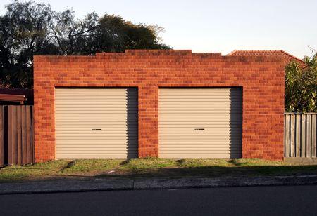 Two Garage Doors, Red Brick Wall, Evening Light photo