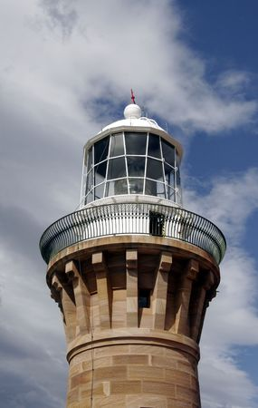 Top Of A Lighthouse Brick Tower In Front Of A Cloudy Sky, Sydney, Australia photo