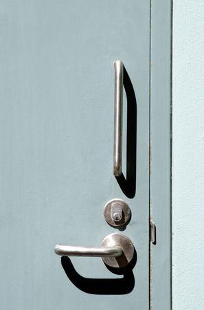 doorhandle: Silver Doorhandle on turquoise door Stock Photo
