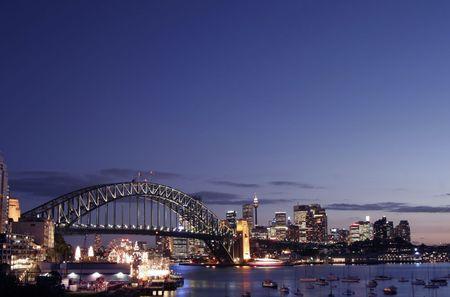 Sydney Harbour Bridge And City Skyline At Sunset, Australia Stock Photo