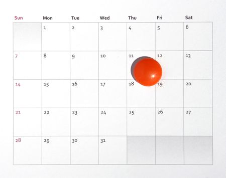 monthly: Deadline - Small Orange Magnet Laying On A  Monthly Business Calendar, Background