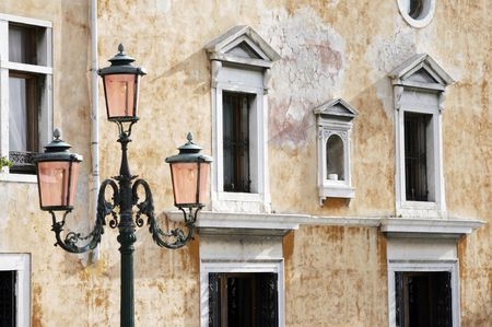 Traditional Street Light In Venice In Front Of Old Building Facade Stock Photo