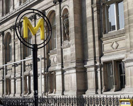 Modern Metro Sign In Paris, Typical Parisian Building Facade photo