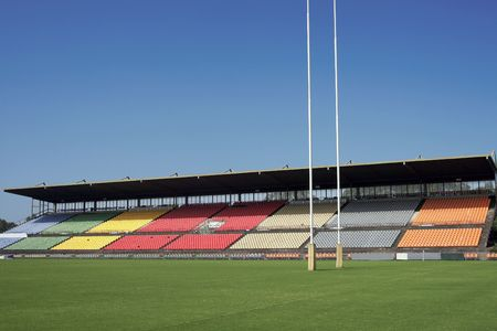 Many Empty Seats In Rows In An Outdoor Sports Stadium