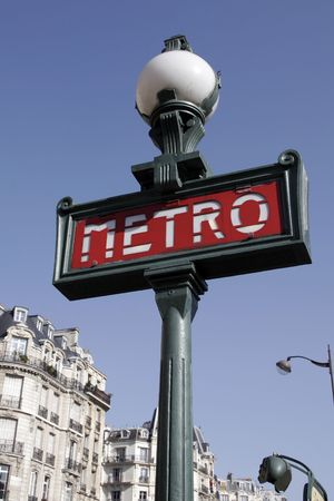 Metro Sign And Street Lamp In Paris, Typical Parisian Building Facade
