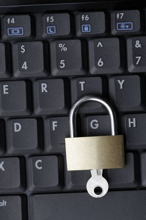 Closed Padlock On A Black Laptop Keyboard, IT Security Concept photo