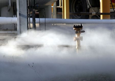 chemical hazard: Chemical Spill - Gas Cloud On The Ground Of An Industrial Plant Stock Photo