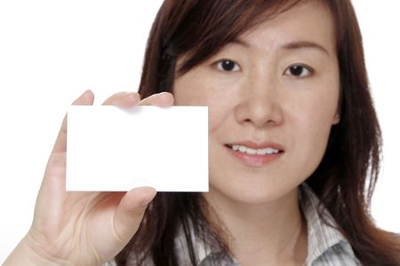 Business Card And Hand In Focus, Attractive Woman In Background Stock Photo