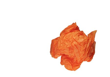 Colse-Up Of An Orange Crumpled Paper Ball On A White Background photo