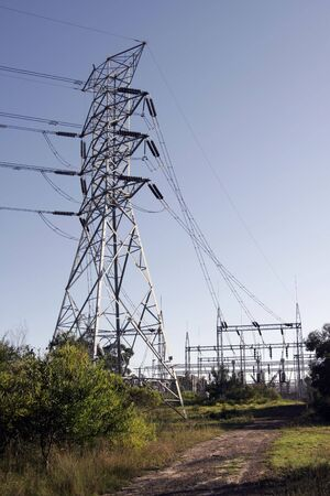 conduction: Metal Power Tower Construction, Electricity Cables, Clear Blue Sky