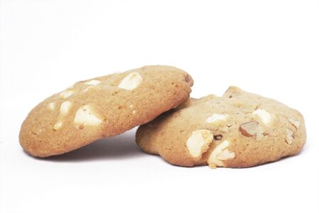 Two Cookie Biscuit With White Chocolate And Macadamia Nuts, Plain Background photo