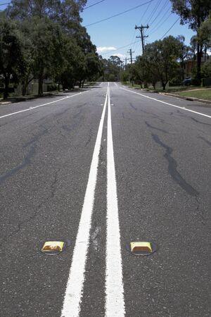 Empty Suburban Street With Line Marking On A Sunny Summer Day, Sydney, Australia photo