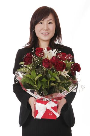 Beautiful Young Asian (Chinese) Businesswoman With Red Roses In Gift Box Stock Photo - 3254466
