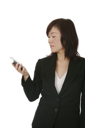 Beautiful Young Asian (Chinese) Businesswoman With Modern Mobile Phone Stock Photo - 3324787