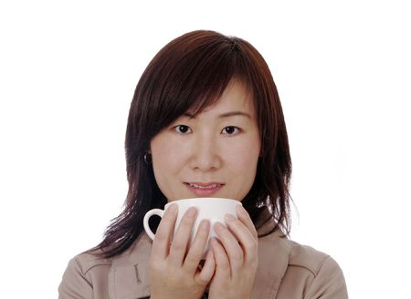 Beautiful Young Asian (Chinese) Businesswoman With White Coffee Cup photo