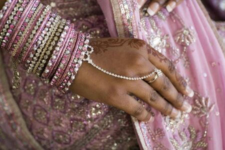 Brides Hand With Henna Tattoo And Jewellery Indian Wedding Stock Photo