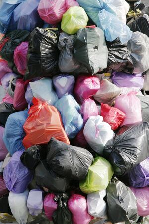 garbage bag: Many Garbage Plastic Bags With Different Colours Piled Up