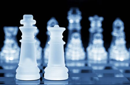 battling: Chess King and Queen, Focus On Front, Blue Toning Stock Photo