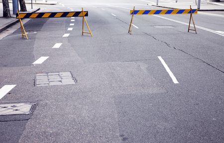 obstruct: Two Barricades On A Urban City Road  Street